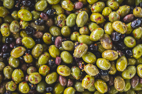 Overhead view of olives with chili flakes for sale at market stall - CAVF60594