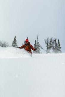 Hiker skiing on ski slope against sky - CAVF60603