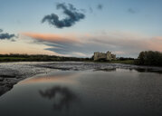 United Kingdom, Wales, Pembrokeshire, Carew Castle and Carew River in the evening - ALRF01367