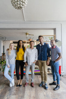 Portrait of confident business team standing in loft office - GIOF05142