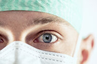 Surgeon with blue eyes, close-up - DAWF00827