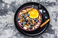 Crunchy muesli with blueberries, slice of orange and cinnamon sticks - SARF04016