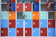 Rows of locker with doors in different colours - AXF00808