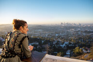 USA, California, Los Angeles, woman looking out from Griffith Observatory at sunrise - DAW00833