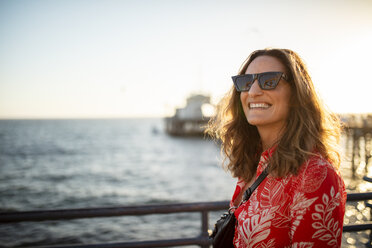 USA, California, Santa Monica, portrait of smiling woman at the waterfront - DAWF00872
