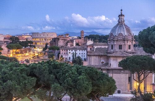 Italy, Rome, Chiesa di San Lorenzo in Miranda and Colosseum in the evening light - HAMF00545
