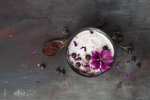 Bowl of natural yoghurt with Aronia powder and hollyhock flower - MYF02062