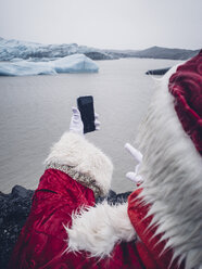 Santa Claus with mobile phone in north pole. - OCMF00185