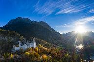 Germany, Bavaria, Hohenschangau, Aerial view of Neuschwanstein Castle in autumn - AM06468