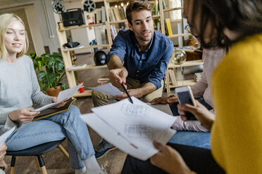 Business team discussing during a meeting in loft office - GIOF05244