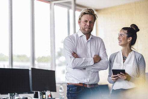 Portrait of an entrepreneur and his assistant standing in office - RIBF00785