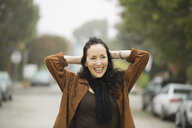 Smiling woman standing outdoors - HEROF00128