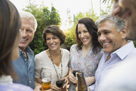 Friends enjoying drinks outdoors - HEROF00269