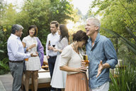 Couple with drinks at outdoor party - HEROF00290