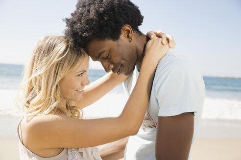 Affectionate couple on beach - HEROF00368
