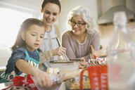 Three generation family baking together during Christmas - HEROF00461