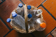 Plastic water bottles recycled in basket - FSIF03499