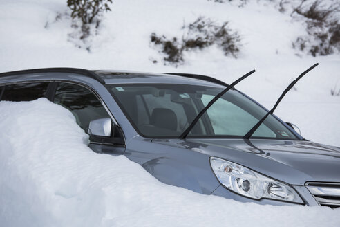 Car parked in snow with windshield wipers up - FSIF03688