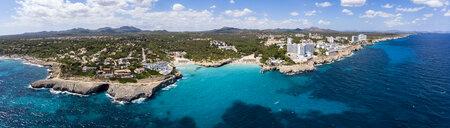 Spain, Baleares, Mallorca, Porto Colom, Aerial view of Cala Tropicana and Cala Domingo - AMF06480