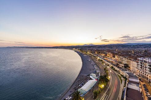 France, Provence-Alpes-Cote d'Azur, Nice, Promenade des Anglais, beach in the evening light - WDF04952