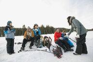 Multi-generation family taking a break from snowshoeing - HEROF00878