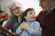 Grandson with grandparents at home during Christmas - HEROF00914