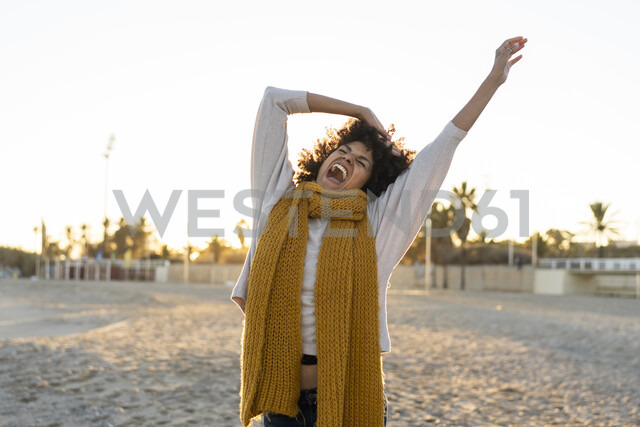 Happy woman having fun on the beach at sunset - AFVF02161
