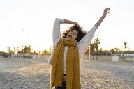 Happy woman having fun on the beach at sunset - AFVF02161