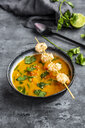 Bowl of sweet potato soup with  shrimps, coconut flakes and fresh coriander - SARF04020