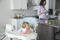 Cute baby girl with mother in kitchen - HEROF01018