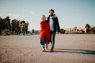 Full length shot of a young couple walking in the street - INGF10618