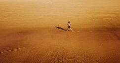 High angle view of a woman running on land - INGF10804