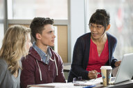 Professor and college students talking at table - HEROF01251