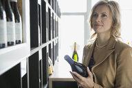 Woman shopping in wine store - HEROF01275