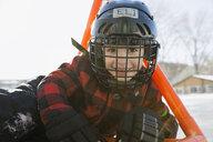 Portrait of smiling boy in ice hockey helmet - HEROF01284