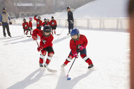 Young hockey players practicing on ice rink - HEROF01404