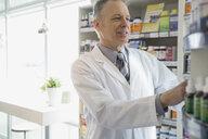 Pharmacist working in market - HEROF01479