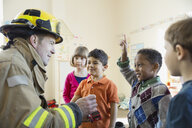 Firefighter with students in elementary school - HEROF01509