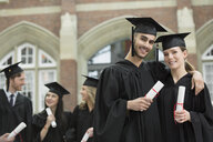 Portrait of confident college graduates with diplomas - HEROF01557