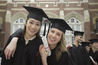 Portrait of confident college graduates with diploma - HEROF01560