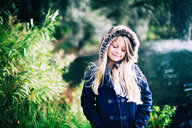 Portrait of a smiling young girl outdoors - INGF10809