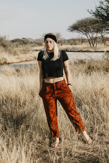 Africa, Namibia, blonde woman in grassland - LHPF00222