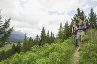 Couple hiking on trail near mountains - HEROF01716