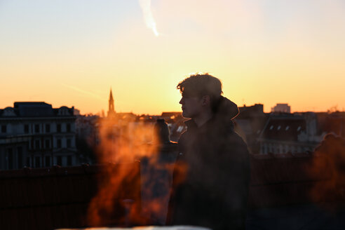 A man in the city at sunset - INGF10925