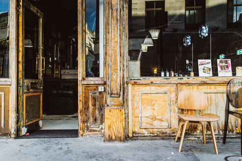 Empty chairs and tables outside a cafe - INGF10928