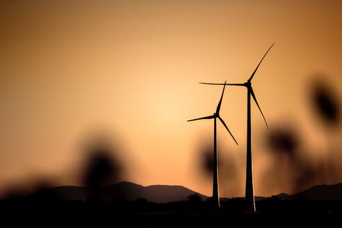 Silhouette of renewable wind turbines during sunset - INGF11018