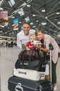 Family of three looking forward to their holiday at CGN airport, Cologne, NRW, Germany - MFF04716