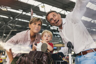 Family of three looking forward to their holiday at CGN airport, Cologne, NRW, Germany - MFF04719