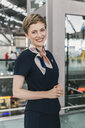 Portrait of smiling airline employee at the airport - MFF04725