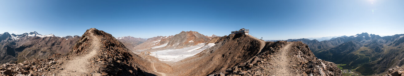 Panoramic view of snow capped mountains in the sun - INGF11216